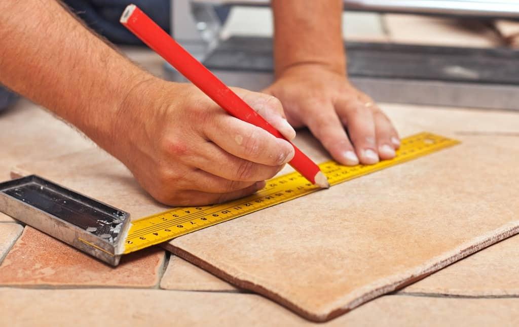 Laying Ceramic Floor Tiles Man Hands Marking Tile To Be Cut Closeup Casa Si Design